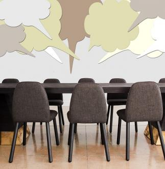 Image of conference room with speech bubbles